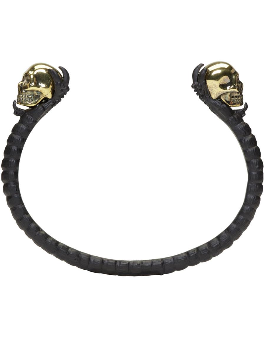ALEXANDER MCQUEEN Black & Gold Twin Skull Claw Cuff