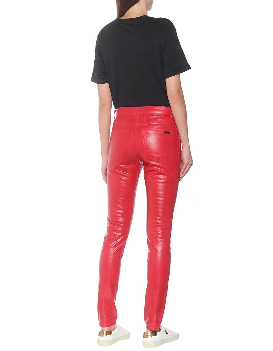 SAINT LAURENT Mid rise skinny coated cotton jeans